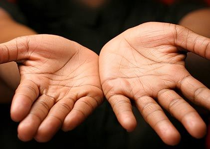 Which hand reflects past Karma