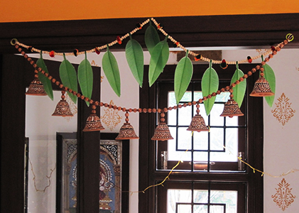 Decorate home with mango leaves and marigold flowers